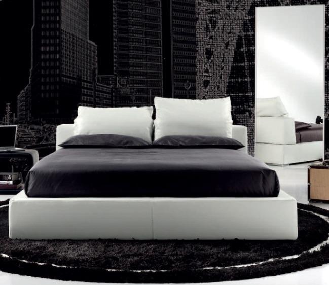Черно белая спальня с кроватью подиумом