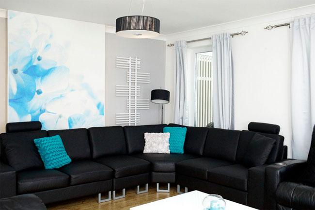 Большой черный диван для обустройство дома