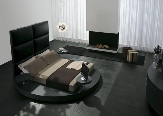 Черная кровать круглой формы