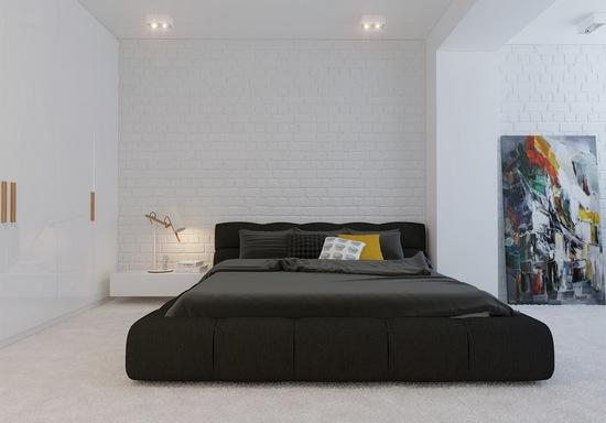 Черная кровать на фоне белых стен