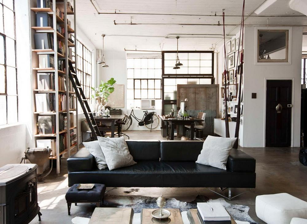 Черный диван отлично вписывается в современный интерьер
