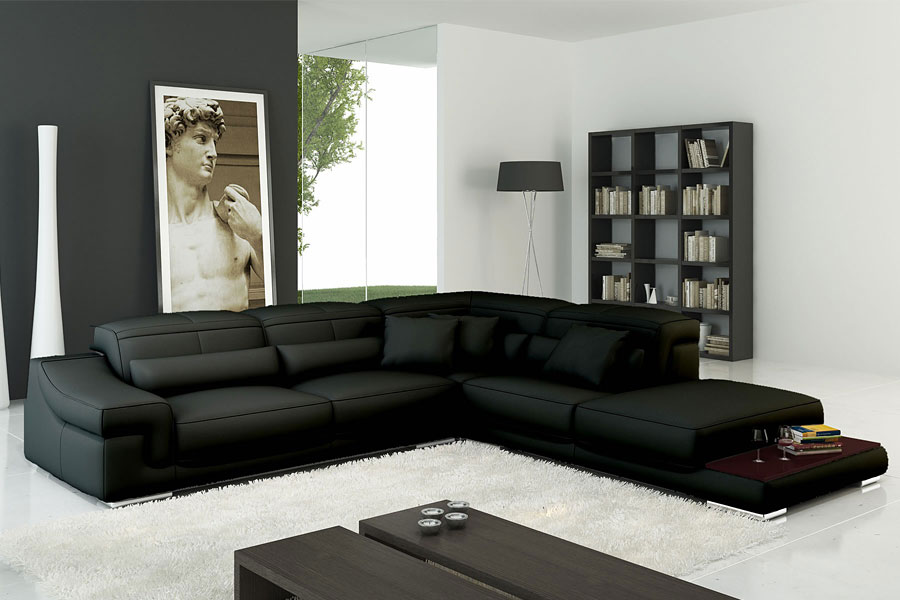 Фото интерьера с черными диваными