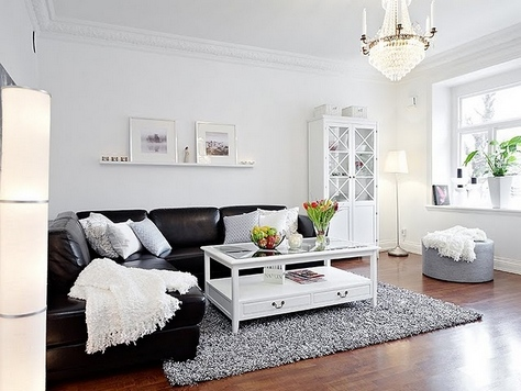 Как правильно использовать черный диван в интерьере
