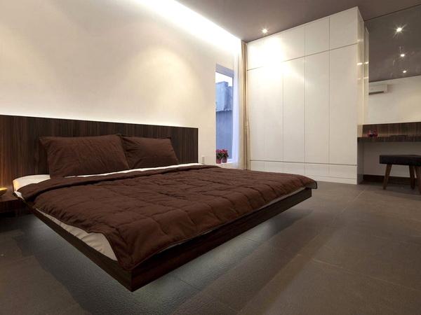 Кровать в стиле лофт, выполенная в коричневом цвете