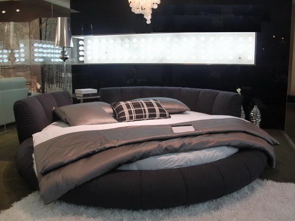 Круглая форма современной черной кровати