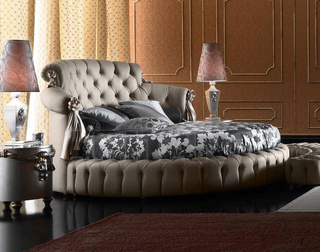 Круглая серая кровать в интерьере