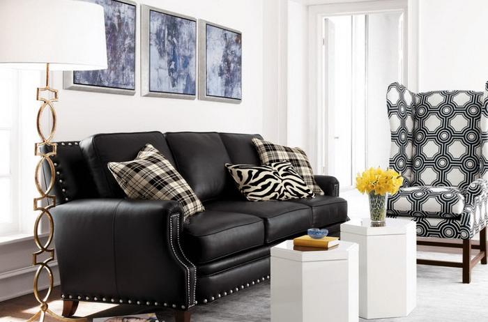 Мягкий черный диван для обустройства дома