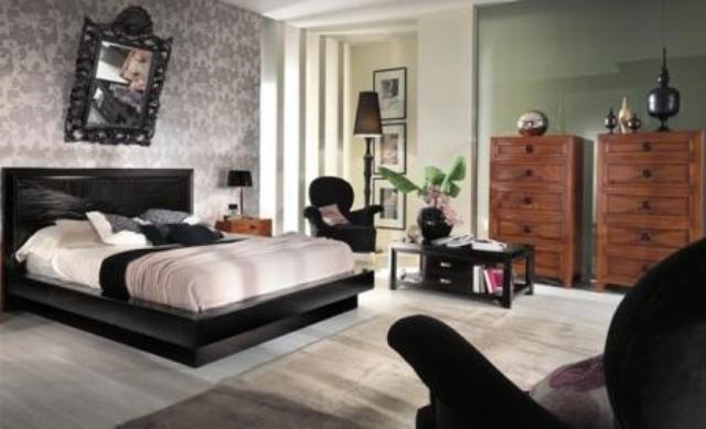 Пример оформления спальни с черной кроватью