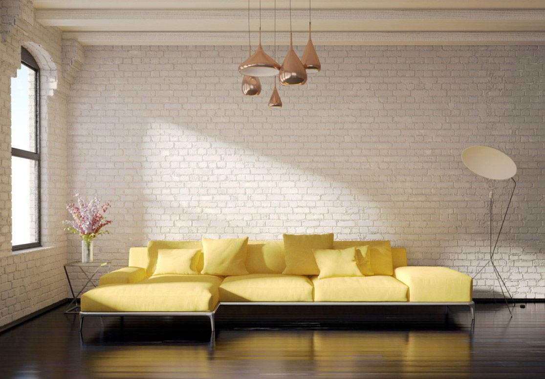 Желтый диван в интерьере лофт