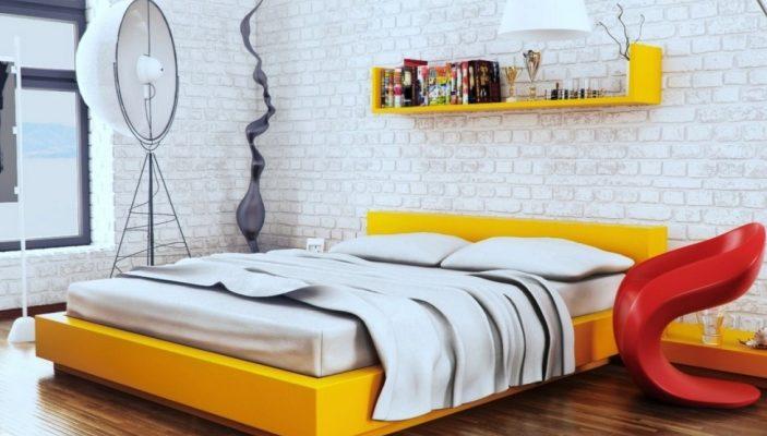 Желтая кровать в интерьере в стиле лофт